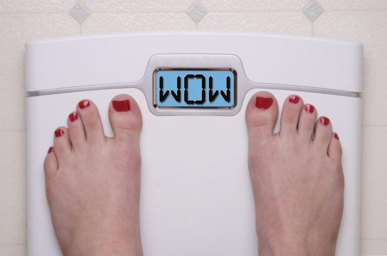 Digital Bathroom Scale Displaying OMG Message