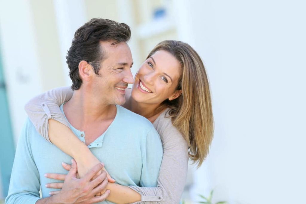 Couple lovingly embracing after hormone replacement therapy